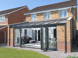 Glass roof extension with bi-folding doors