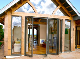 Extension with bi-folding glass panel door